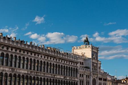 procuratie: Procuratie Vecchies arcades and Torre dellOrologio in Saint Marks Square in Venice, Italy Editorial