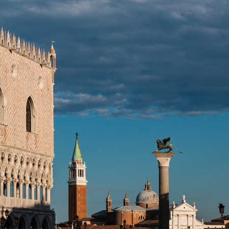 Doges Palace, San Giorgio Maggiore Bell Tower and Winged Lion Column in Venice, Italy Editorial