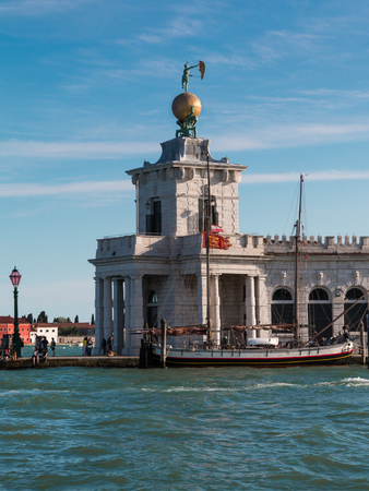 Punta della Dogana in Venice with Golden Ball at the Grand Canal in Venice, Italy