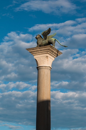 leon alado: Bronze Winged Lion Column in St. Marks Square, venice, Italy