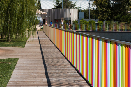 Wooden Deck with Colorful Fence near Children Playground Stock Photo