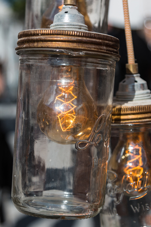 Vintage Electric Carbon Light, Amber Bulb Filament inside Can Stock Photo