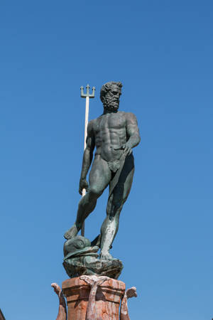 Neptune Bronze Statue with Trident Scepter and Blue Sky in background