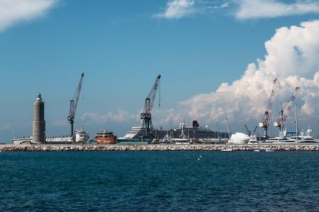 livorno: Cranes at Work in Boatyard near Lighthouse