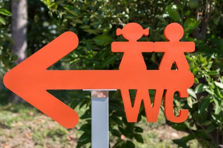 watercloset: Children WC Red Arrow-shaped Sign: Restroom Symbol