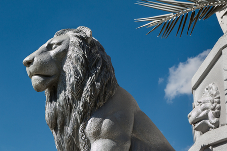 Silver Lion Sculpture and Blue Sky in background Stock Photo
