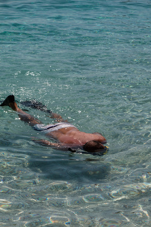 Man in Crystalline Sea with Fins, Swimsuit and Divers Mask