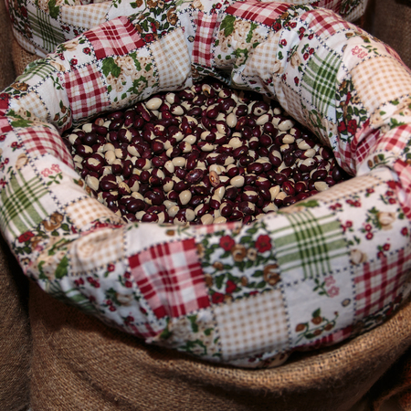 roman beans: Red Calypso Beans inside Jute Sack for Sale at Market