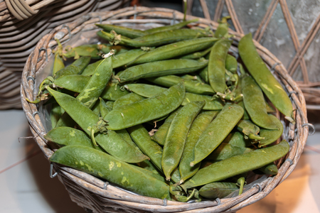 snap bean: Green Romano Beans inside Wicker Box for Sale at Market Stock Photo