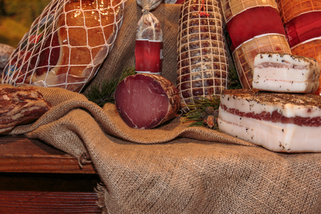 Assortment of Cured Meats and Salami in Butcher Shop Stock Photo