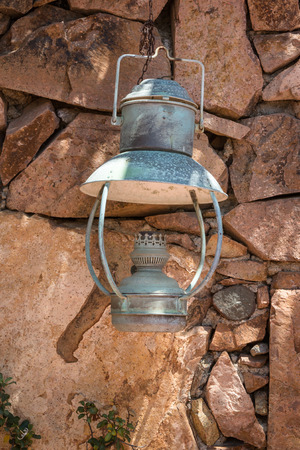 tradional: Old Antique Oil Lantern Hanging on a Stone Wall
