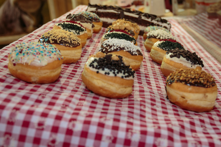 Assorted Icing Donuts on Gingham Tablecloth