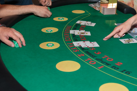 Inside Casino: Behind Black Jack Gambling Table, Chips and Cards Archivio Fotografico