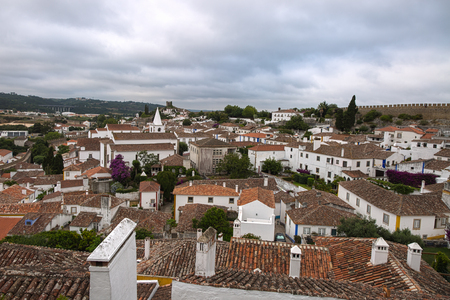 heritage protection: View from Medieval Portuguese City of Obidos Walls: Rooftops and Houses Stock Photo