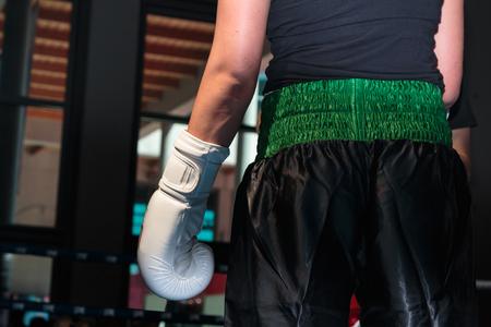 pugilist: Female Pugilist Boxe: Closeup of White Glove and Black Shorts