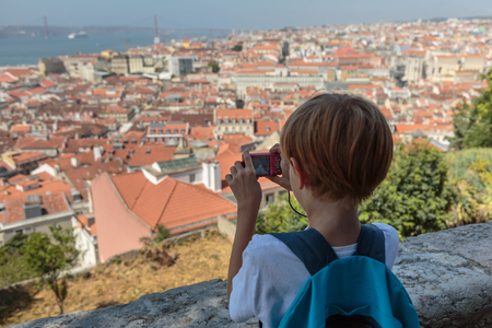 Child Takes Panoramic Photos from Sao Jorge Castle: Aerial View of Lisbon Stock Photo