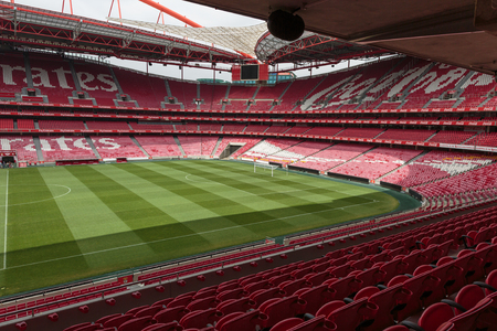View of Da Luz Stadium: Red Empty Seating and Green Soccer Pitch - Lisbon, Portugal Banco de Imagens - 85366264