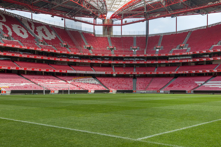 View of Da Luz Stadium: Red Empty Seating and Green Soccer Pitch - Lisbon, Portugal Editorial