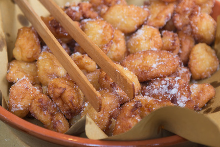 crostoli: Typical Carnival italian Fritters: Sweet Dough Balls with Icing Sugar