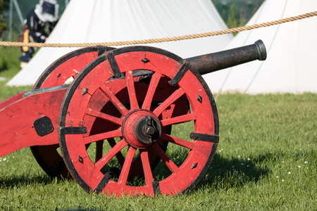 Antique Medieval Red Metallic Cannon on Wheels