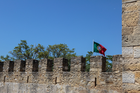 george: Castle of Sao Jorge: External Wall and Portuguese Flags Stock Photo