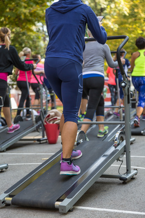 Women in Sportswear Exercising Outdoor on Treadmills