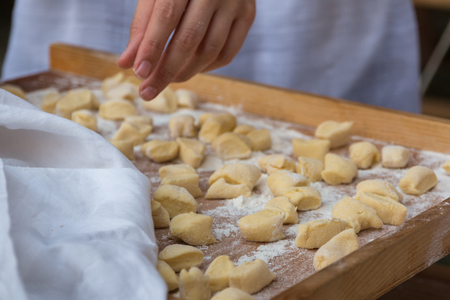 Small Dumplings on Wooden Board with Flour: Italian Gnocchi Past