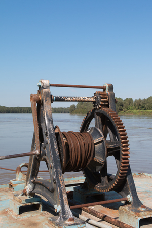 Fluvial Port: Rusted and Old Manual Naval Winch Stock Photo
