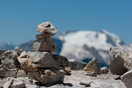 Mountain Ridge in Italian Dolomites Alps in Summer Time and Stones Stacked One Onto Each Other.