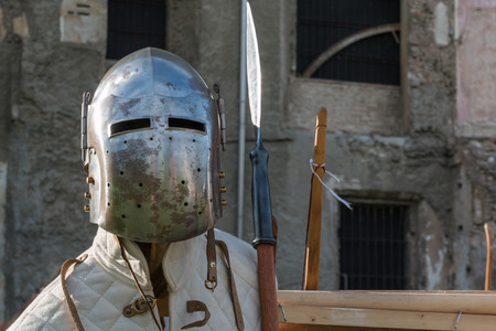 Medieval Iron Helmet and Pole Weapon, Medieval Theme. Stock Photo