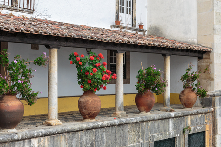 Colonnade Courtyard with Cobblestone Floor and Ornamental Vase. Stock Photo