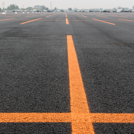 Empty Public Parking Lot with Orange Lines Stock Photo