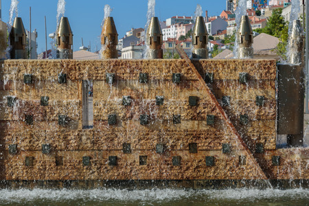 Fountains Wall with Flowing Water in Portugal.