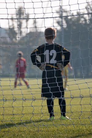 Little Soccer Player: Goalkeeper with Gloves in front of Goal. Фото со стока