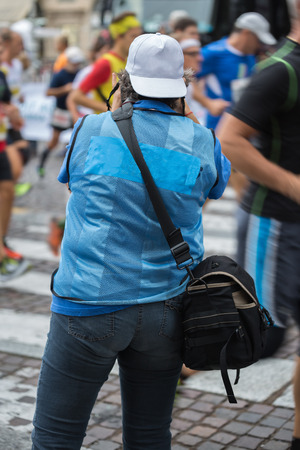 Sport Photographer Shooting Marathon Runners in the Street during City Race.
