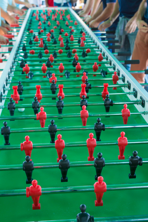 Very Long Table Football Game for Fifty Players Simultaneously.