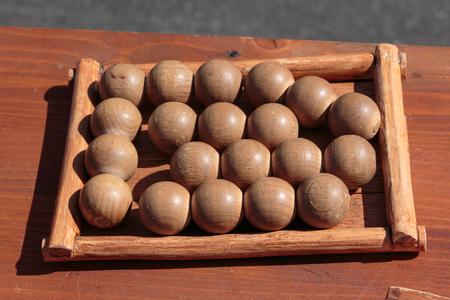 Little Wooden Balls on Table inside Rectangular Field: Antique Game. Standard-Bild