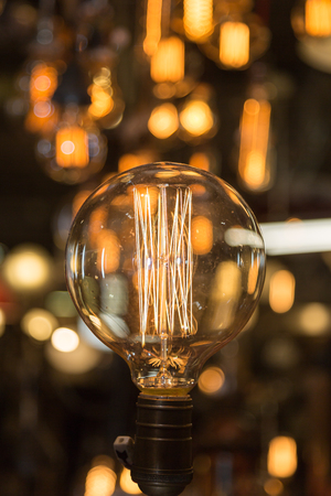 Single Vintage Electric Light Bulb with Incandescent Filament.