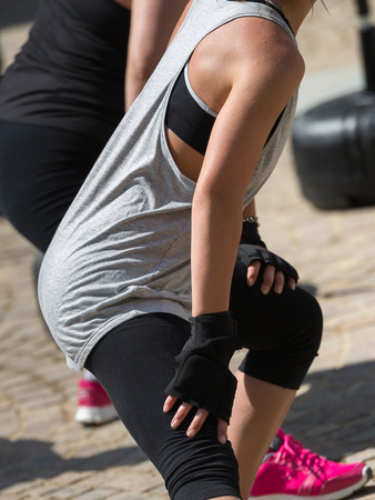 Girls with Punching Gloves doing Stretching Exercises before Fitness Workout at Outdoor Gym.