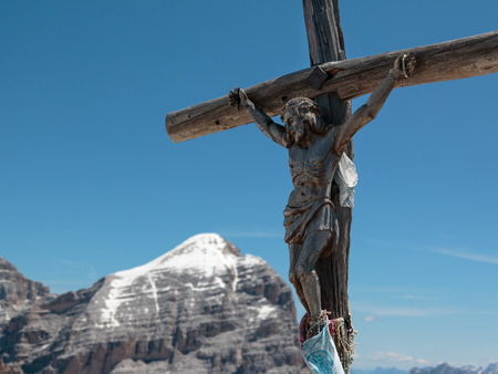 Wooden Christian Cross and Italian Dolomites Alps in Background in Summer Time.