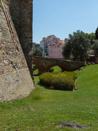 Bridge, Wall, Meadow and Houses near Castle of Sao Jorge in Lisbon Portugal.