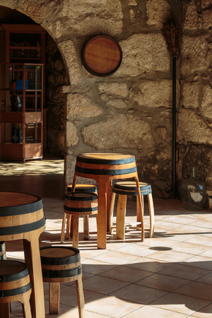 Empty Wine Bar with Arch Stone Architecture and Wooden Stool Barrel Shaped Standard-Bild