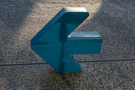 Blue Plastic Sign with Empty Direction Arrow.