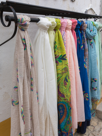 Colorful scarves on Iron Hanger in a Store.