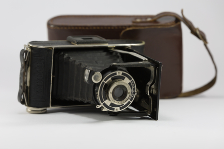 Ancient Folding Camera with Bellows and Brown Leather Case.