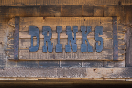 Drink Insignia, Text Symbol on Wooden Planks.