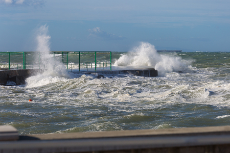 Sea Waves Breaking against Seashore Promenade in Windy Day: Stormy Weather.