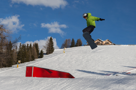 Snowboarder in Action: Jumping in the Mountain Snowpark.