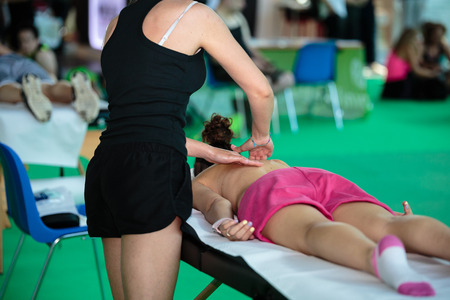Athlete s Back Professional Massage after Fitness Activity - Wellness and Sport Editorial