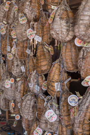 Delicious Culatello Forms Hanging inside a Restaurant.